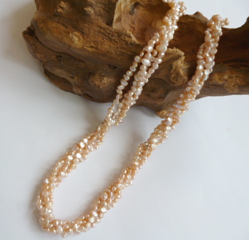 A 'Chunky' necklace of tiny Peach-Pink Pearls.