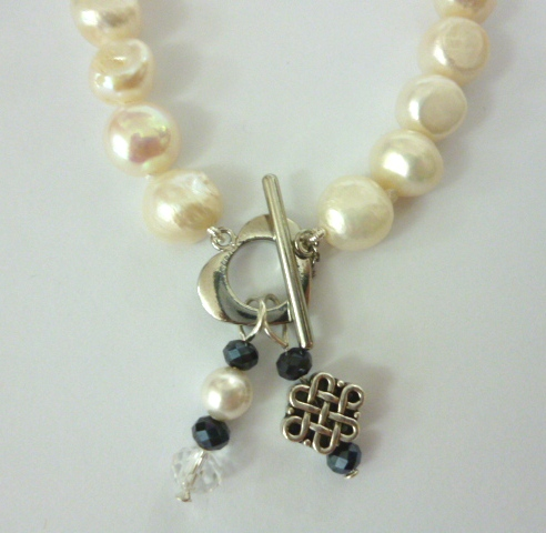 Baroque Pearl Bracelet with Celtic Style 'Infinity' Knot and Blue Crystal Pendant
