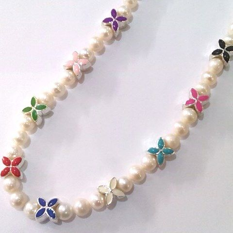 enamel flowers on a pearl necklace