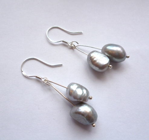 Grey pearl double drop ear-rings on silver hooks.