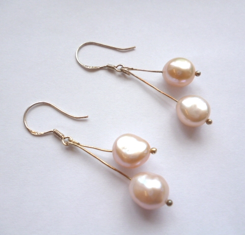 Peach pearl double drop ear-rings.