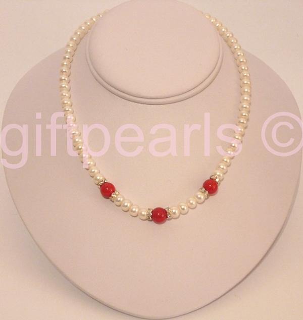 Pearl necklace with featured coral gemstones.