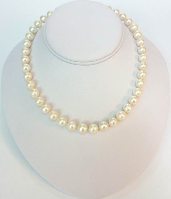 Super Quality Large Pearls with 14 carat gold clasp.