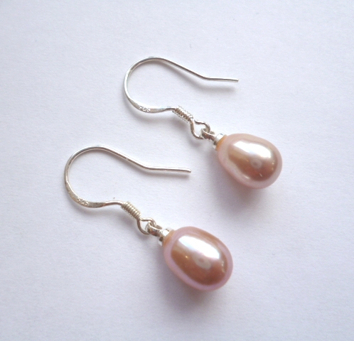 Tear-drop Lavender pearls on silver hooks.
