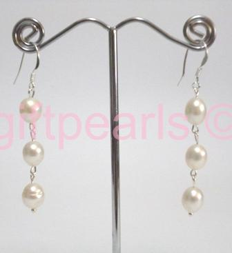 Triple pearl drop ear-rings on silver hooks.