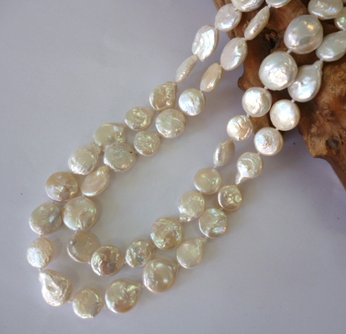 Two-Strand oval button pearls with carved shell clasp.