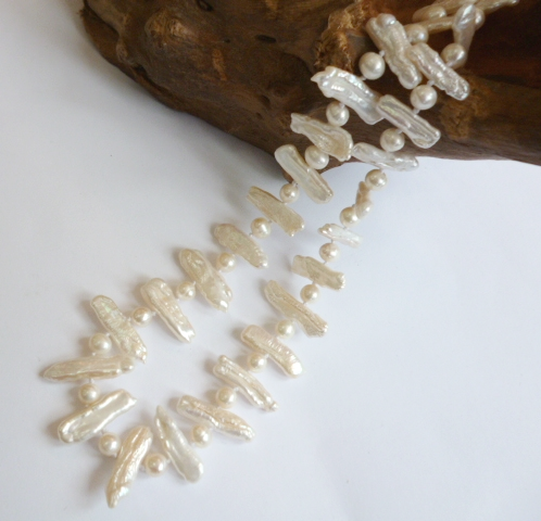 White 'Biwa' pearl with small pearls